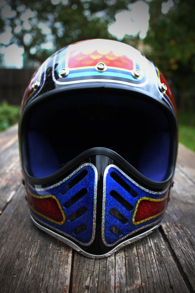 Vintage restored Motostart helmet. The helmet is been completily restored and refurbished. The shell is body worked, primed, base coat, flaked,candys, clear coat. The helmet is been painted with monster house of kolor rainbow flakes. The candy job is done with house of kolor candys. The helmet is been clear coat with 2pac clear. The inside is been replace and clean. Pick up from moorabbin or i can post anywhere.